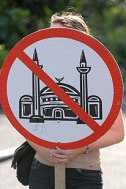 Protestor holds a sign against proposed Islamic center